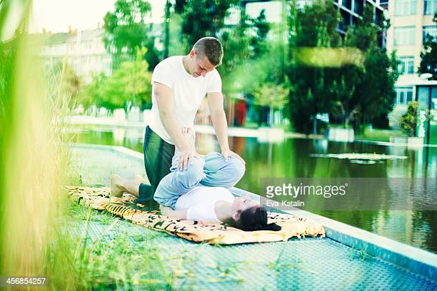 massage outdoors - thai massage stock photos and pictures