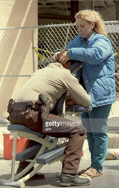 Massage therapist and court reporter Vicki Maltsberger gives Custer County Sherriff Mike Burgess an massage outside the Alfred P Murrah Federal...