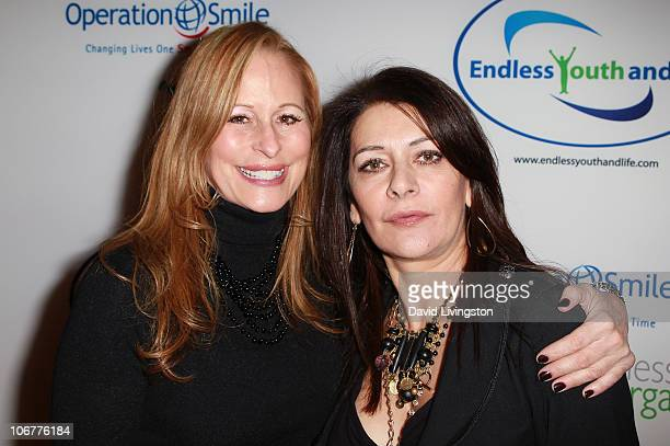 Massage therapist Cinthia Dahl and actress Marina Sirtis attend the Endless Youth & Life store opening celebration on November 11, 2010 in Beverly...