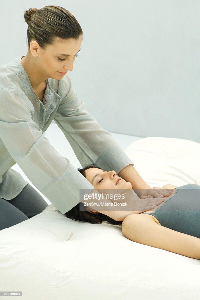 Massage therapist giving woman chest massage : Stock Photo