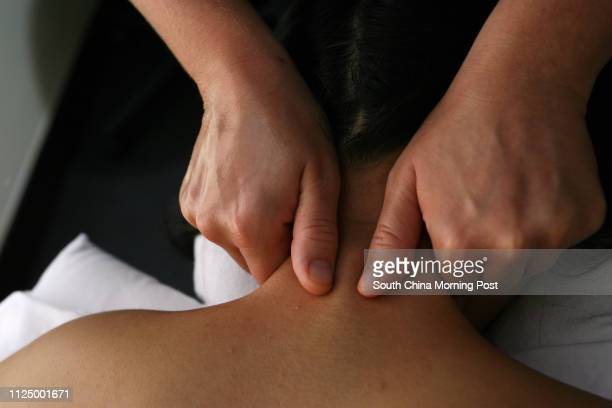Massage therapist Jenny Woolsey director of SutherlandChan Centre massages a patient's shoulders and back in one of the treatment rooms at the...