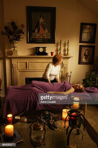 Massage Therapist Sara Seals gives Kelly Markiewicz a massage in the living roomPhotos are of a mobile spa Party at the home of Roz Markiewicz in...