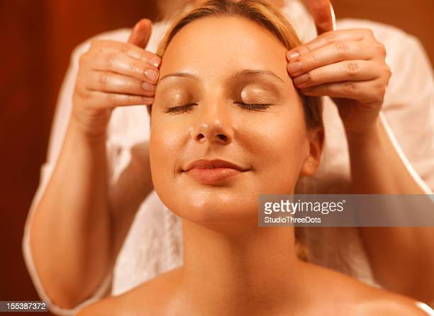 massage treatment for temples - pressure point stock photos and pictures