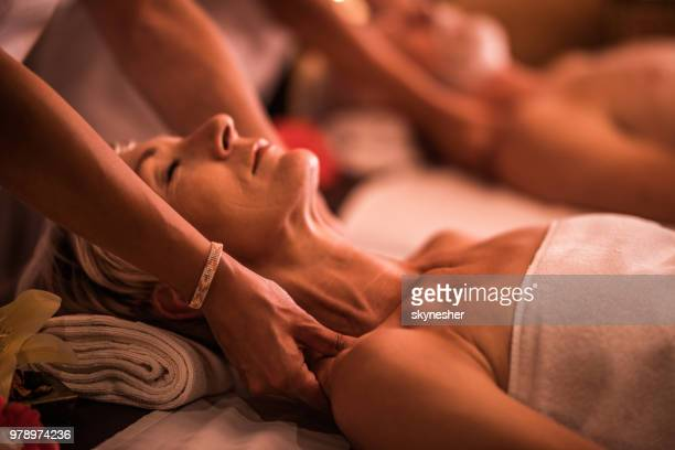 massaging senior woman at the spa! - spa treatment stock pictures, royalty-free photos & images