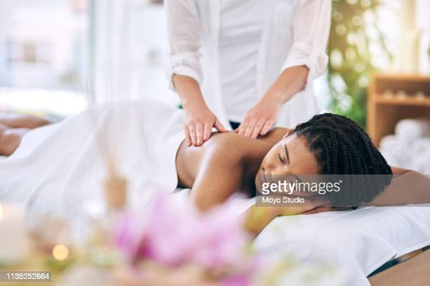 massaging the chaos of life away - massage stock pictures, royalty-free photos & images