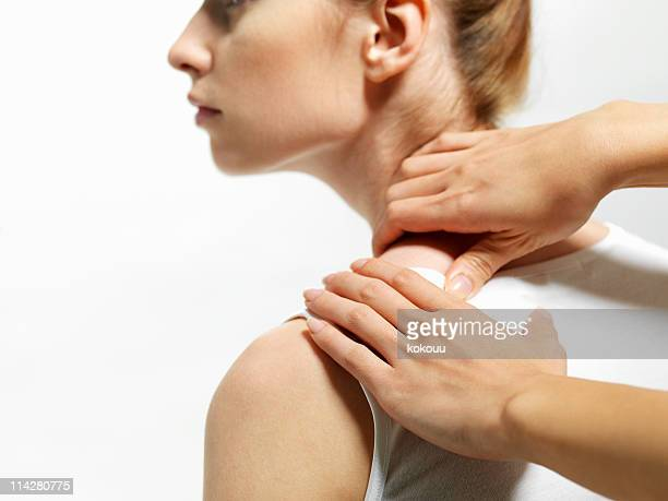 Massaging the shoulders of women