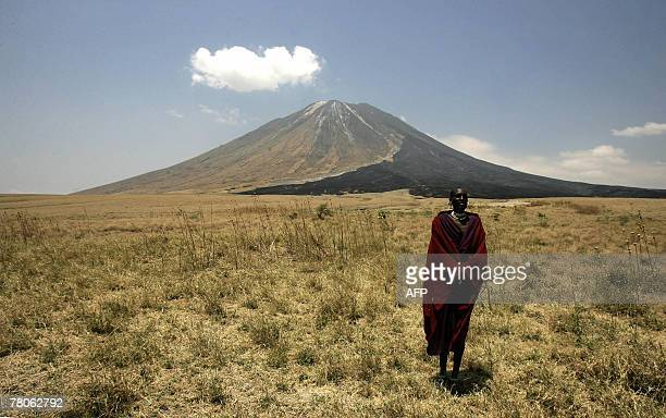 A Massai tribesman stands on the slopes leading up to the Ol Doinyo Lengai volcano in the Ngorongoro Conservation Area northern Tanzania 30 August...