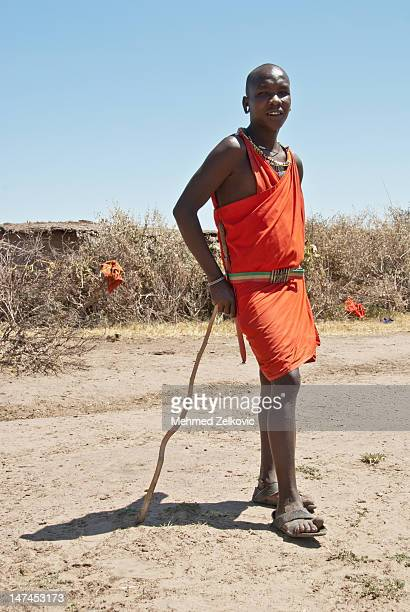 Massai warrior next to his village