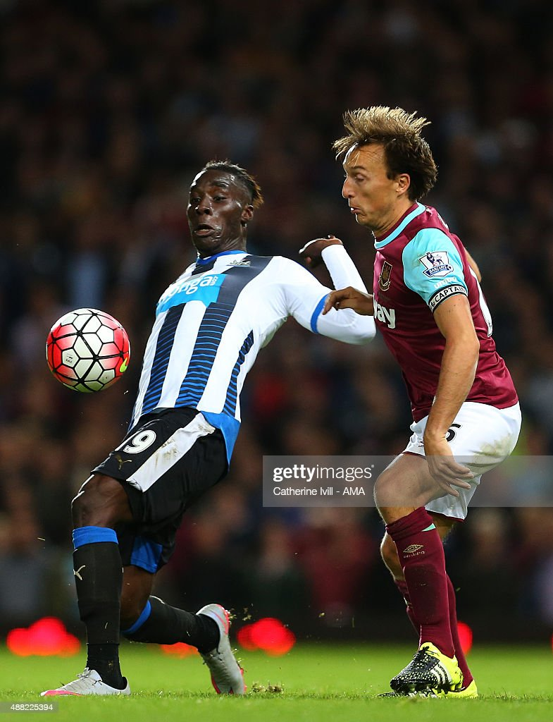 Massaiso Haidara of Newcastle United and Mark Noble of West Ham United during the Barclays Premier League match between West Ham United and Newcastle United on September 14, 2015 in London, United Kingdom.