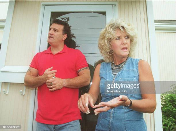 Joey Buttafuoco and his wife Mary Jo Buttafuoco in front of their Massapequa New York home as they were interviewed by members of the media on July 1...