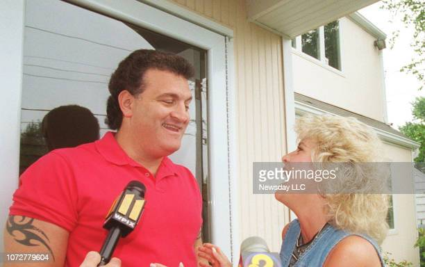 Joey Buttafuoco and his wife Mary Jo share a lighter moment in front of their Massapequa New York home as they are interviewed by members of the...