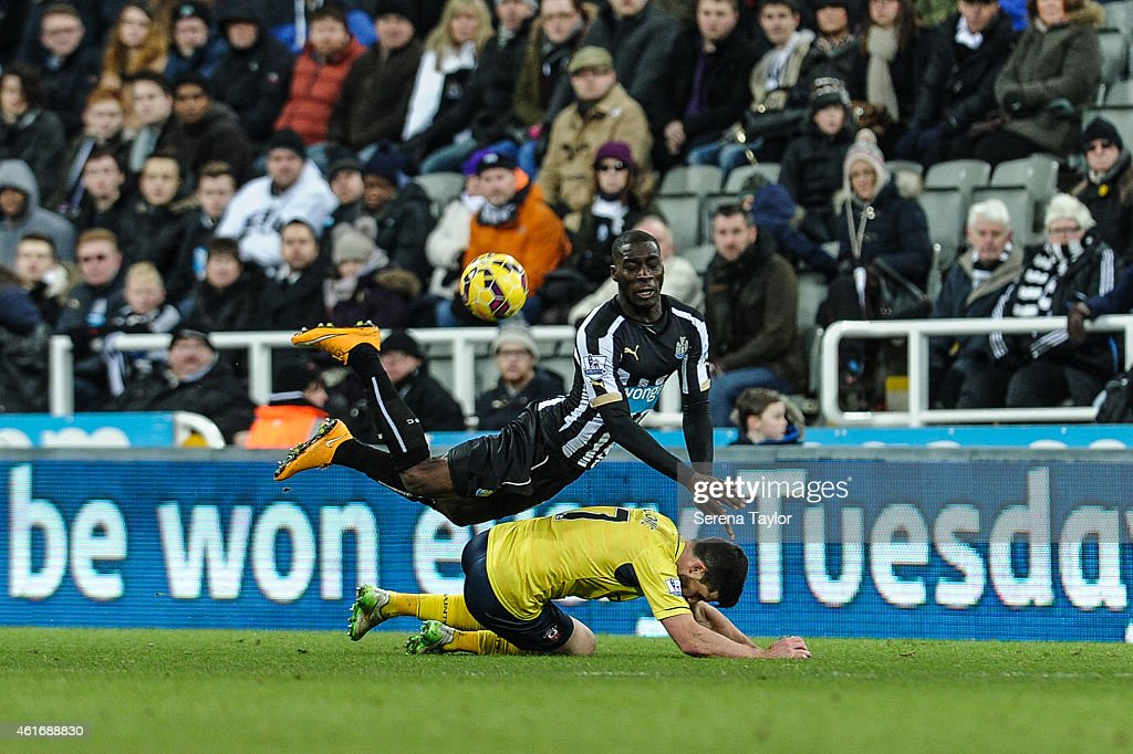 Massasio Haidara of Newcastle makes a flying dive to win the ball from Shane Long of Southampton during the Barclays Premier League match between Newcastle United and Southampton at St.James' Park on January 17, 2015, in Newcastle upon Tyne, England.