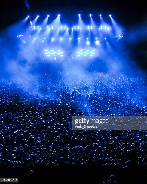 Massed crowd of fans watches the main stage lightshow on Day 2 of Reading Festival 2009 on August 29, 2009 in Reading, England.