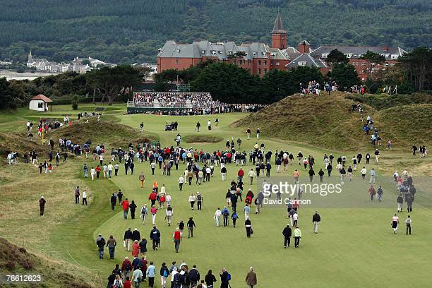 Massed crowds follow Rory McIlroy of Ireland and Billy Horschel of the USA on the 9th hole in the afternoon singles matches during the 2007 Walker...