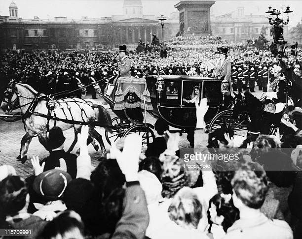 Massed crowds in Trafalgar Square London watch as Princess Elizabeth now Queen Elizabeth II returns from Westminster Abbey to Buckingham Palace after...