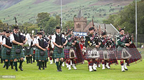 massed pipe bands at brodick highland games, arran. - highland games stock pictures, royalty-free photos & images