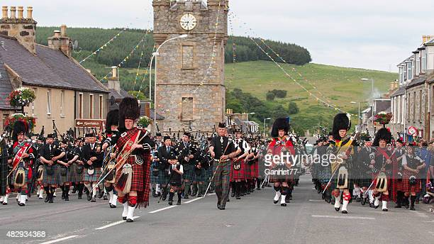 Massed Pipe Bands marching in Dufftown, Scotland.