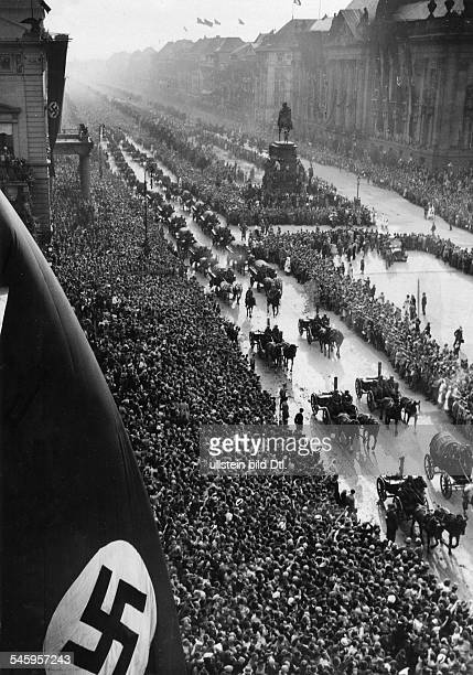 Masses of people lining the street Unter den Linden in Berlin to watch the parade of the Wehrmacht from Brandenburg Gate to Lustgarten center...