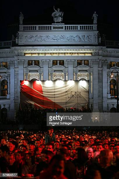 Masses of people stand on Rathausplatz in front of the Burgtheater during the opening of the Lifeball 2005 at Vienna City Hall on May 21 2005 in...