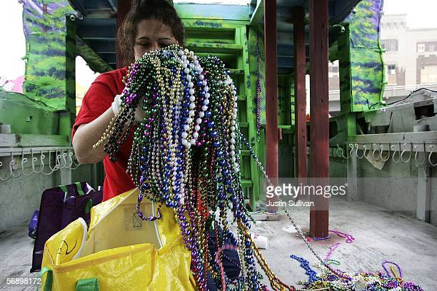 Massett and Company employee Sharon Salvaggio cleans up beads from a Mardi Gras float February 21 2006 in the Ninth Ward of New Orleans Louisiana...