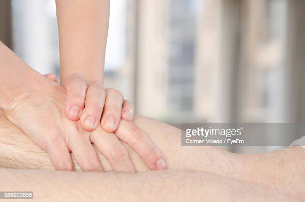 Masseuse Rubbing Leg