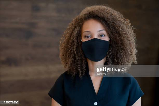 masseuse working at a spa and wearing a facemask - protective face mask stock pictures, royalty-free photos & images