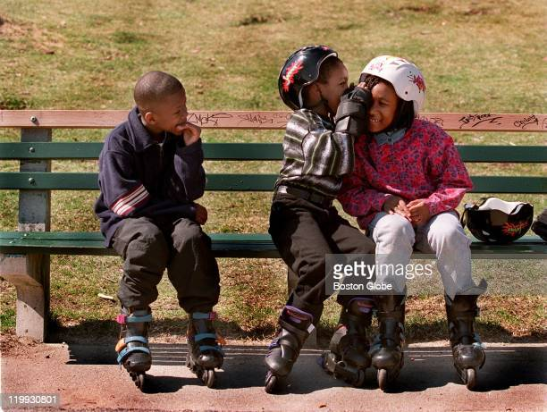 J Massey left waits patiently as siblings Cameron center and Vivian Showell share a secret before the trio heads off to rollerblade around Jamaica...