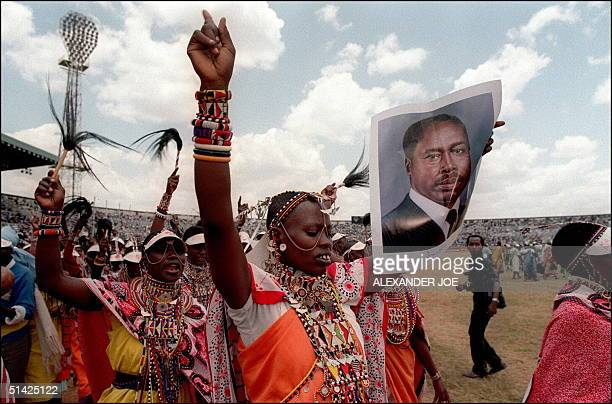 Massi supporters of Kenya's President Daniel Arap Moi shown in a picture dated 9 October 1992 in Nairobi as they sing and dance with photos of Moi...
