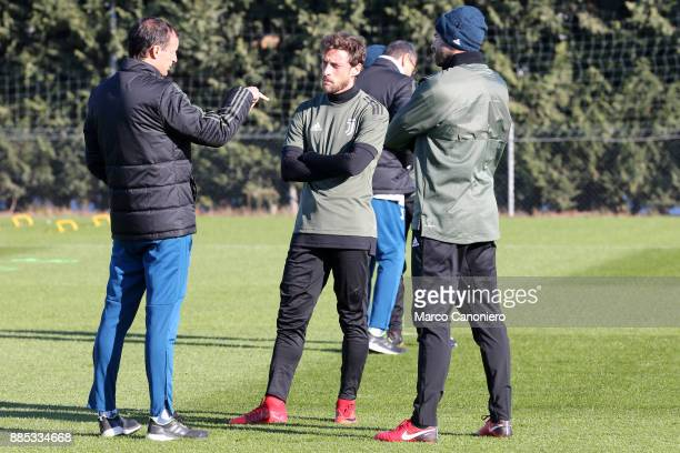 Massimiliano Allegri head coach of Juventus FC with Andrea Barzagli and Claudio Marchisio during the Juventus FC training on the eve of the UEFA...