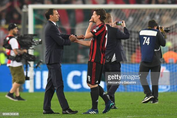 Massimiliano Allegri head coach of Juventus shankes hands with Riccardo Montolivo of AC Milan after the TIM Cup Final between Juventus and AC Milan...