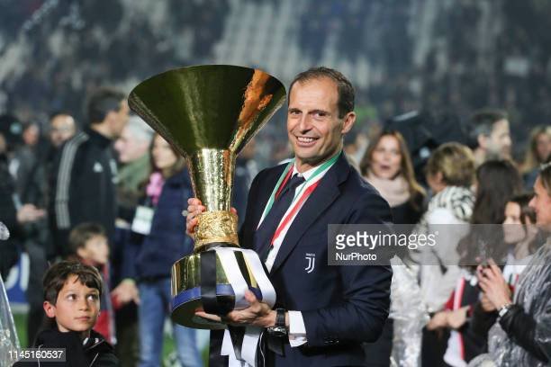 Massimiliano Allegri with the trophy of Scudetto during the victory ceremony following the Italian Serie A last football match of the season Juventus...