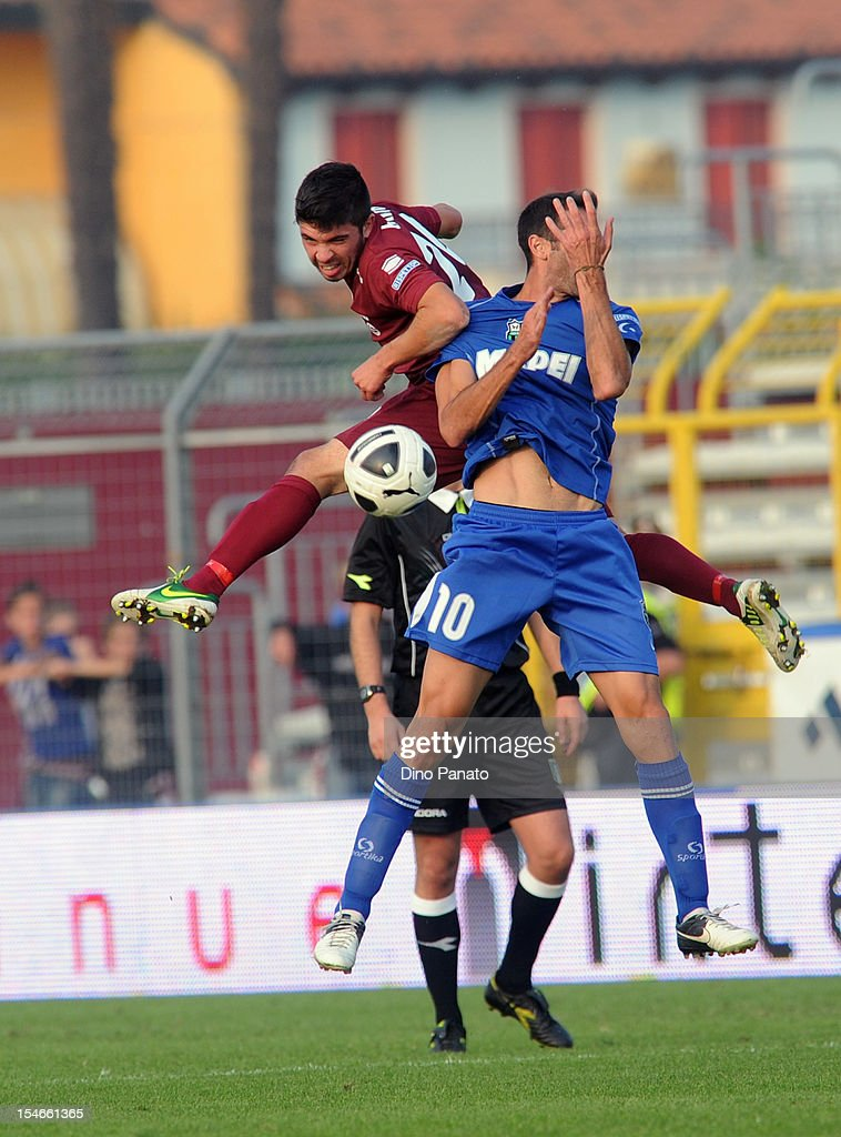 Massimiliano Busellato (L) of AS Cittadella competes in the air with Michele Troiano of US Sassuolo Calcio during the Serie B match between AS Cittadella and US Sassuolo Calcio at Stadio Pier Cesare Tombolato on October 20, 2012 in Cittadella, Italy.