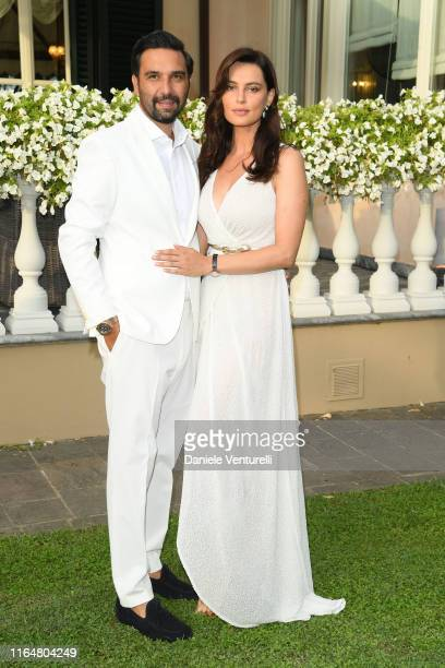 Massimiliano Di Lodovico and Catrinel Marlon poses at the Andrea Bocelli Celebrity Fight Night 2019 on July 28 2019 in Forte dei Marmi Italy