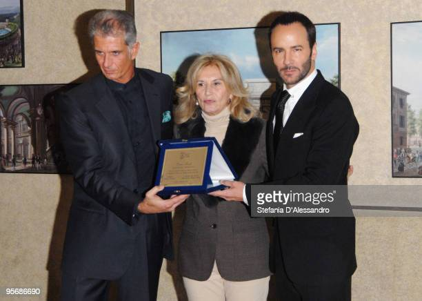 Massimiliano Finazzer Flory Vania Traxler Protti and Tom Ford pose with the Onorary Award received by Tom Ford for his care in Fashion Design and...