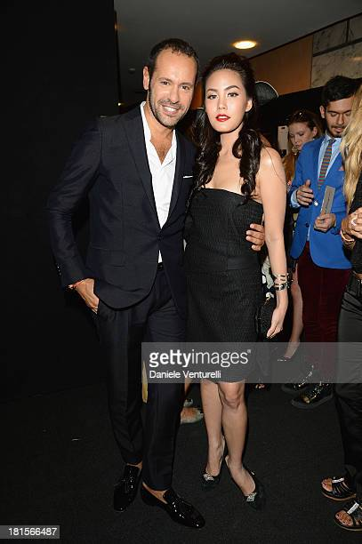 Massimiliano Giornetti and Janie Tienphosuwan attend the Salvatore Ferragamo show as part of Milan Fashion Week Womenswear Spring/Summer 2014 at on...