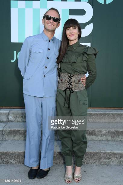 Massimiliano Locatelli and Victoria Cabello attend miu miu club event at Hippodrome d'Auteuil on June 29 2019 in Paris France