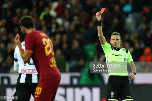 Massimilino Irrati referee shows the red card to Federico Fazio of AS Roma during the Serie A match between Udinese Calcio and AS Roma at Stadio...
