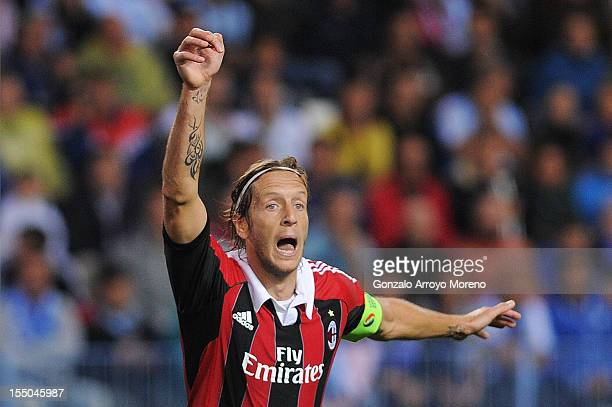 Massimo Ambrosini of AC Milan claims for a penalty shoot out during the UEFA Champions League group C match between Malaga CF and AC Milan at the...