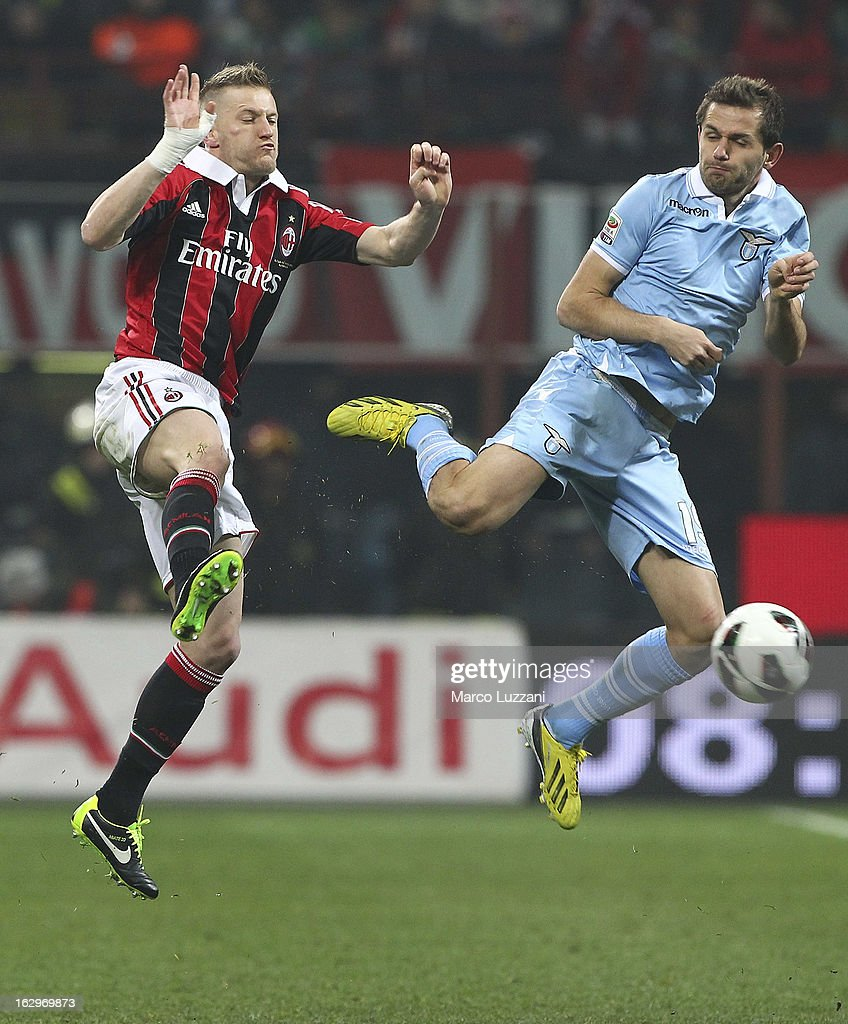 Massimo Ambrosini of AC Milan competes for the ball with Senad Lulic of S.S. Lazio during the Serie A match between AC Milan and S.S. Lazio at San Siro Stadium on March 2, 2013 in Milan, Italy.