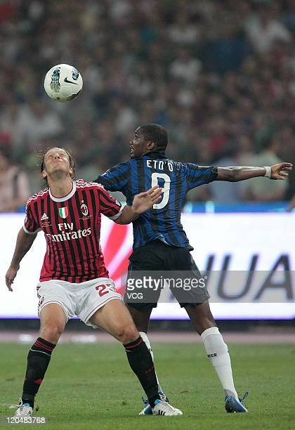 Massimo Ambrosini of AC Milan heads for a ball against Samuel Eto'o Fils of Inter Milan during the Italy Super Cup Final match between AC Milan and...