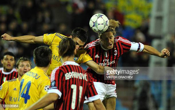 Massimo Ambrosini of AC Milan vies for the ball with Marco Simic of Bate Borisov during their UEFA Champions League Group H football match in Minsk...