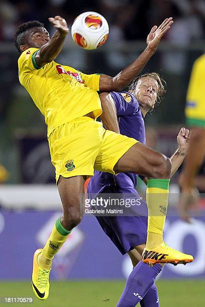 Massimo Ambrosini of ACF Fiorentina fights for the ball with Christian Irobiso of FC Pacos de Ferreira during the UEFA Europa League Group E match...