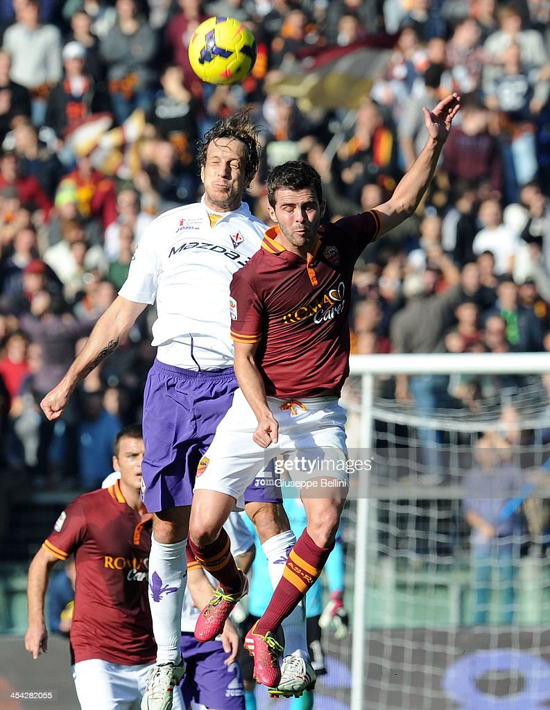 Massimo Ambrosini of Fiorentina and Miralem Pjanic of Roma in action during the Serie A match between AS Roma and ACF Fiorentina at Stadio Olimpico on December 8, 2013 in Rome, Italy.