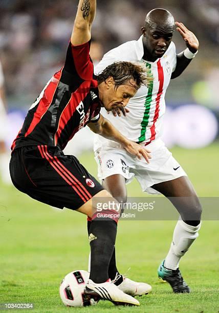 Massimo Ambrosini of Milan and Mohamed Sissoko of Juventus during the TIM preseason tournament at Stadio San Nicola on August 13 2010 in Bari Italy
