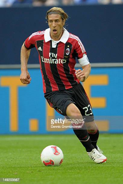 Massimo Ambrosini of Milan controls the ball during the friendly match between Schalke 04 and AC Milan at VeltinsArena on July 24 2012 in...