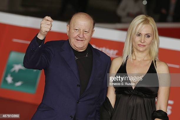 """Massimo Boldi and Loredana De Nardis attend the """"Il Postino"""" red carpet during the 9th Rome Film Festival on October 26, 2014 in Rome, Italy."""