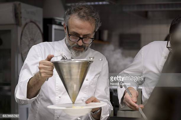 Massimo Bottura chef patron of the threeMichelinstar restaurant Osteria Francescana cooks pasta during the celebration for Eataly 10th anniversary...