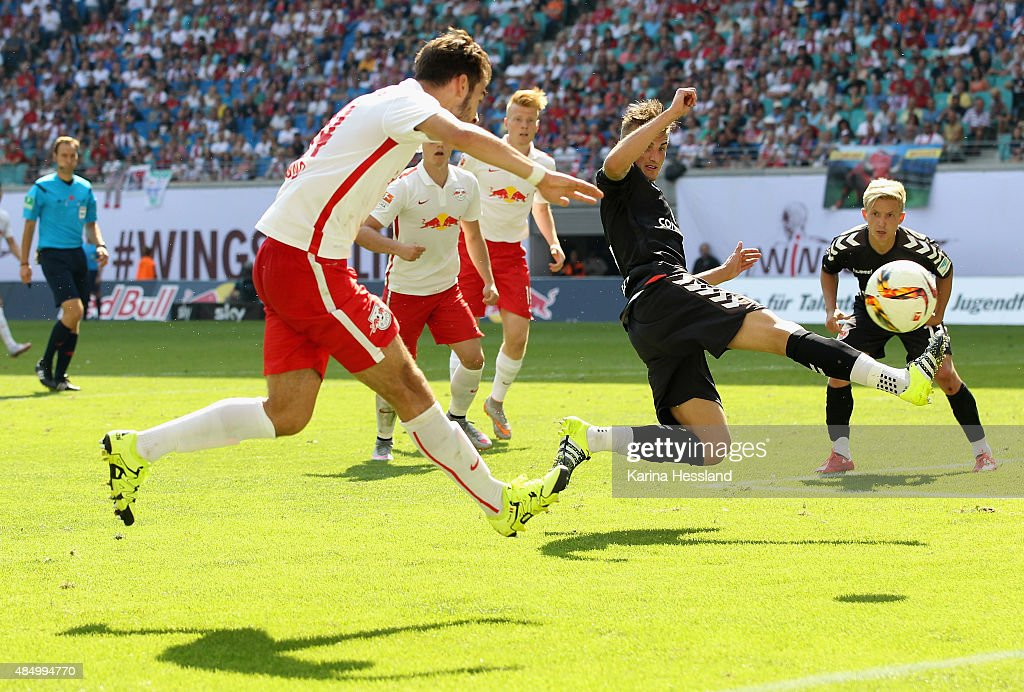 Massimo Bruno of Leipzig challenges Philipp Ziereis of St. Pauli during the Second League match between RB Leipzig and FC St.Pauli at Red-Bull Arena on August 23, 2015 in Leipzig, Germany.