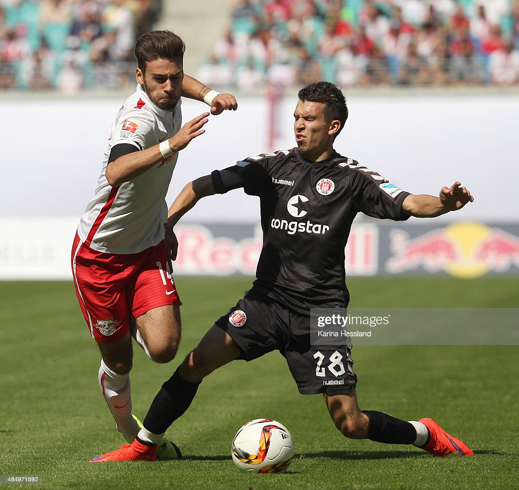 Massimo Bruno of Leipzig is challenged by Waldemar Sobota of St. Pauli during the Second League match between RB Leipzig and FC St.Pauli at Red-Bull Arena on August 23, 2015 in Leipzig, Germany.
