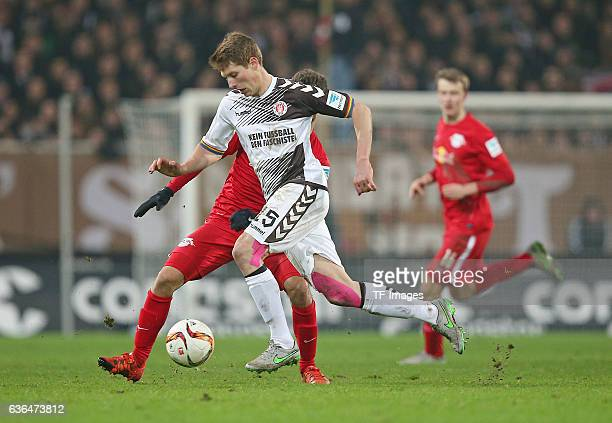 Massimo Bruno of RB Leipzig and Daniel Buballa of St Pauli battle for the ball during the Second Bundesliga match between FC St Pauli and...